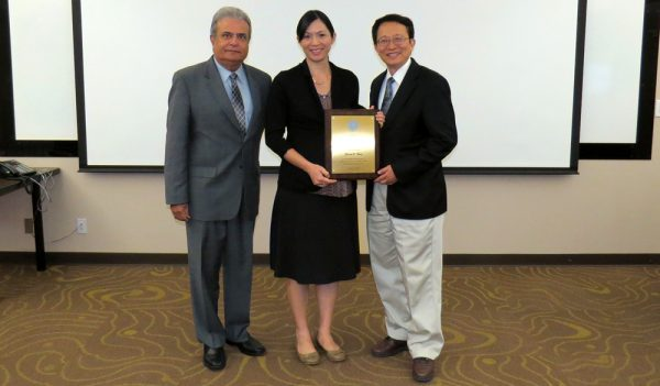 Sharon Hong Receives a plaque of appreciation for three years of dedicated service to the board.